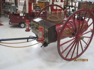 1890 Hand Drawn Chemical Cart. It has twin 20 gal. tanks that would contain water, soda and a small container of acid which combined to expel the water used in extinguishing the fire. Used in Hunter Oklahoma from 1890 to 1910
