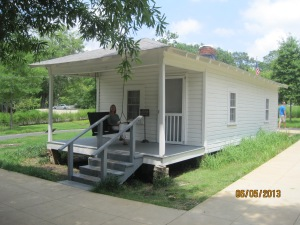 Diane on the front porch of the house Elvis was born in.