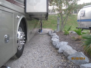If I had not moved a couple of the rocks you see we certainly would have had paint damage. Like most of you with motor homes our bay doors open out farther than our slides go out. Always ALWAYS beware.