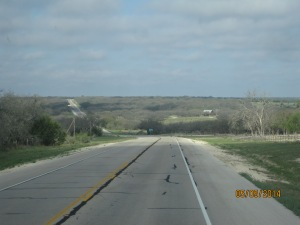 Just a stretch of road outside of Fredericksburg. The clouds gave way to a very sunny day shortly after.
