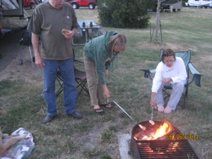 Rich, Diane and Chris testing their smores making abilities.