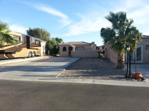 This site has gravel parking with a large concrete patio and a casita.