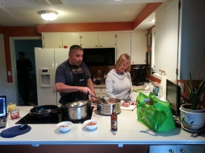 Diane getting a lesson on how to make authentic Chili Verde.