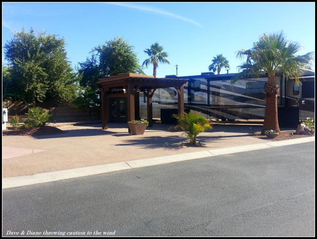 Another nice site with extensive block work and a shade cover. Behind the RV is a small casita.