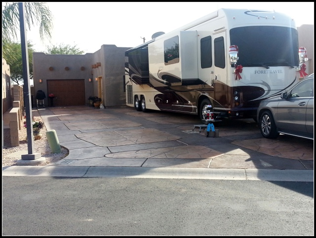 This is a nice spot with a Casita behind the RV, an outdoor living area behind the Casita and a garage.