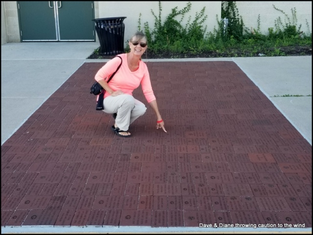 Diane is pointing to a brick with our friends Roger & Lynn's name on it outside of the stadium.