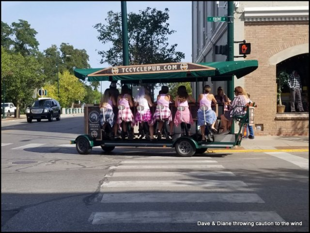 A bachelorette party making the rounds on one of those peddle powered things downtown Traverse City .