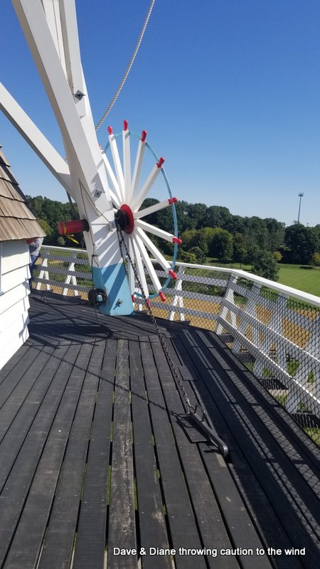 In order to catch the wind from different directions the top of the windmill can be turned. It's done by the system in this picture and is held in place by the chain and hook.