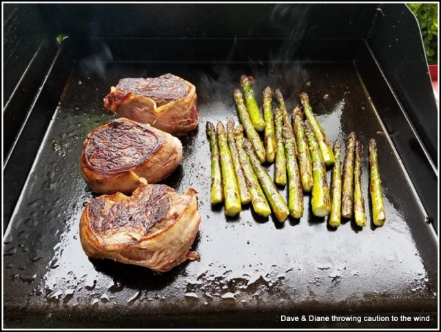 Bacon wrapped sirloin and asparagus