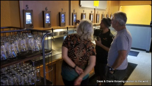 """Steve & Diane getting a """"how to pour"""" at the Thirsty Donkey. A self serve bar!!"""