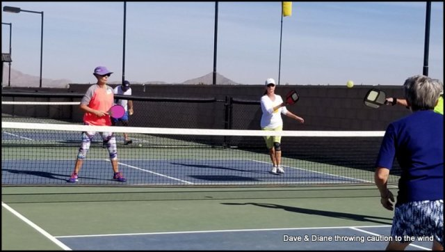 Diane on the opposite side of the net on the right. OOps, that ball looks a little high Diane, get ready to eat it!!