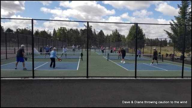 Diane is on the left court in the blue top.